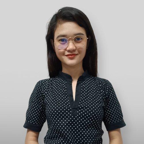 A woman with polka dots shirt smiling